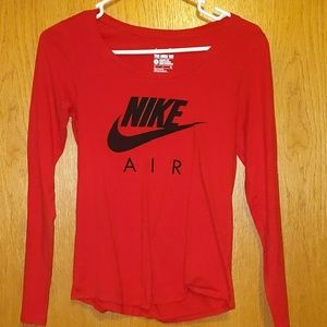 Red long sleeve shirt with black nike air logo